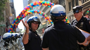Police officers listen to a briefing before the start of the NYC Pride Parade in New York, Sunday, June 26, 2016.  (AP Photo/Seth Wenig)