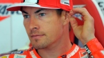 In this Friday, June 14, 2013 file photo, Nicky Hayden, of the U.S sits in his garage at the Montmelo racetrack in Montmelo, outside Barcelona. (AP Photo/Manu Fernandez, File)