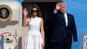 US President Donald Trump and his wife Melania, wave as they leave from Ben Gurion airport near Tel Aviv, Israel, Tuesday, May 23, 2017. (AP Photo/Ariel Schalit)