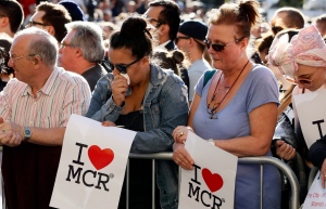 People attend a vigil in Albert Square, Manchester, England, Tuesday May 23, 2017, the day after the suicide attack at an Ariana Grande concert that left 22 people dead as it ended on Monday night. (AP Photo/Kirsty Wigglesworth)