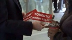 """Mayor John Tory was out pushing for the downtown relief line handing out flyers saying """"Toronto needs relief."""" (CP24)"""