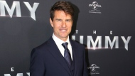 """In this Monday, May 22, 2017 file photo, actor Tom Cruise arrives for the Australian premiere of his movie """"The Mummy,"""" in Sydney. (AP Photo/Rick Rycroft, File)"""