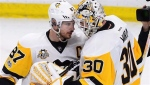 Pittsburgh Penguins centre Sidney Crosby (87) celebrates with Penguins goalie Matt Murray (30) after defeating the Ottawa Senators in game four of the Eastern Conference final in the NHL Stanley Cup hockey playoffs in Ottawa on Friday, May 19, 2017. Sidney Crosby was his usual cool self as he prepared for another monumental game in his already storied career. Getting to the final for the fourth time in less than 10 years would be a remarkable feat on its own for the Cole Harbour, N.S., native and a rarity in today's parity-infested NHL. THE CANADIAN PRESS/Sean Kilpatrick