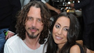 """In this April 27, 2012, file photo, Chris Cornell, at left, and his wife, Vicky Karayiannis attend the celebration of """"Commando: The Autobiography of Johnny Ramone,"""" in Los Angeles. Vicky Cornell penned a letter addressed to the late Soundgarden front man published on May 24, 2017, days after he took his own life.(AP Photo/Katy Winn, File)"""