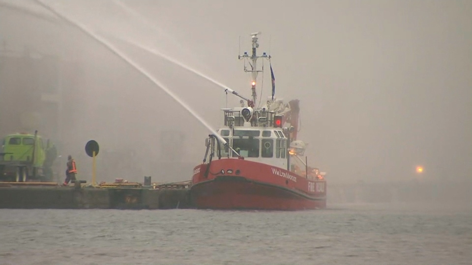 The William Lyon Mackenzie fireboat pumps water onto a six-alarm blaze at a Cherry Street recycling facility on Thursday.