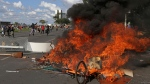 Demonstrators create a flaming barricade with chairs taken from the Ministry of Agriculture during an anti-government protest in Brasilia, Brazil, Wednesday, May 24, 2017. (AP Photo/Eraldo Peres)