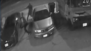 Two men firing handguns at 33-year-old Leonard Pinnock are seen in surveillance camera footage on April 21, 2017. (Toronto police)