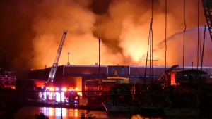 It took several hours for fire crews to get the colossal fire under control. Toronto fire says it could take days to put out hot spots at the recycling facility. (CP24)