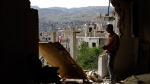 A man surveys damage at the mountain resort town of Zabadani in the Damascus countryside, Syria, on Thursday, May 18, 2017. An estimated 400,000 have been killed and half the population displaced by the 6-year-old civil war. (AP Photo/Hassan Ammar)