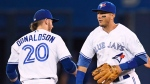 Toronto Blue Jays' Josh Donaldson, left, and Troy Tulowitzki celebrate their victory over the Kansas City Royals during MLB baseball action, in Toronto on Tuesday, July 5, 2016. (Frank Gunn/The Canadian Press)