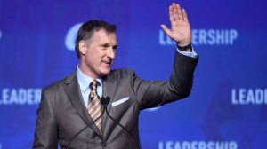 Conservative leadership candidate Maxime Bernier waves to the crowd during the opening night of the federal Conservative leadership convention in Toronto on Friday, May 26, 2017. A final winner will be picked to lead the Conservative Party of Canada on Saturday night. THE CANADIAN PRESS/Nathan Denette