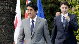 Japanese Prime Minister Shinzo Abe, left, and Canadian Prime Minister Justin Trudeau walk in the Sicilian town of Taormina, Italy, Saturday, May 27, 2017. Leaders of the G7 meet Friday and Saturday, including newcomers Emmanuel Macron of France and Theresa May of Britain in an effort to forge a new dynamic after a year of global political turmoil amid a rise in nationalism. (AP Photo/Andrew Medichini)