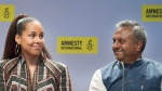 Alicia Keys speaks during a news conference prior to receiving an Ambassador of Conscience Award from Amnesty International recognizing those who have shown exceptional leadership in the fight for human rights in Montreal, Saturday, May 27, 2017, as Amnesty International Secretary General Salil Shetty looks on. THE CANADIAN PRESS/Graham Hughes