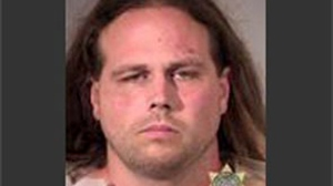 This booking photo provided by Multnomah County Sheriff's Office shows Jeremy Joseph Christian. Authorities on Saturday, May 27, 2017 identified Christian as the suspect in the fatal stabbing of two people on a Portland light-rail train in Oregon. (Multnomah County Sheriff's Office via AP)