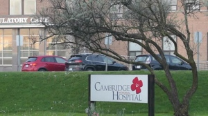 Police say one person is in custody after an ambulance was stolen from a hospital in Cambridge on Sunday morning.