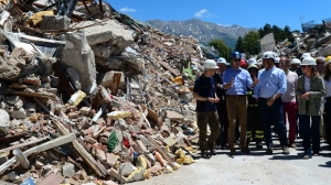 Prime Minister Justin Trudeau and wife Sophie Gregoire-Trudeau are escorted by officials as they visit Amatrice, Italy on Sunday, May 28, 2017. The area was effected by an earthquake that occured in August 2016. THE CANADIAN PRESS/Sean Kilpatrick