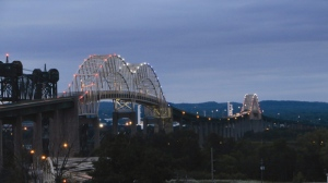 In this photo taken on Wednesday, Aug. 12, 2015, new energy -efficient lights illuminate the International Bridge, seen from the Sault Ste. Marie side, in Mich. (Angela Kipling/The Evening News via AP) MANDATORY CREDIT