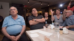 Maxime Bernier supporters react as they watch Andrew Scheer being elected the new leader of the federal Conservative party on a television at a gathering in St-Georges Que. on Saturday, May 27, 2017. THE CANADIAN PRESS/Jacques Boissinot