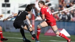 Team Canada's Hannah Darling looks to move past Team New Zealand's Ruby Tui during cup final action at the HSBC Canada Women's Sevens at Westhills Stadium in Langford, B.C., on Sunday, May 28, 2017. New Zealand defeated Canada 17-7. THE CANADIAN PRESS/Chad Hipolito