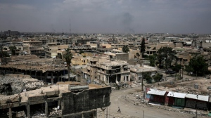 FILE -- In this May 5, 2017 file photo, destroyed buildings from fighting between Iraqi forces and the Islamic State group are seen in western Mosul.  (AP Photo/Bram Janssen, File)