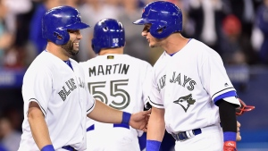 Toronto Blue Jays shortstop Troy Tulowitzki, right, celebrates with designated hitter Kendrys Morales at home plate after hitting a grand slam against the Cincinnati Reds during third inning MLB interleague baseball action in Toronto on Monday, May 29, 2017. THE CANADIAN PRESS/Frank Gunn