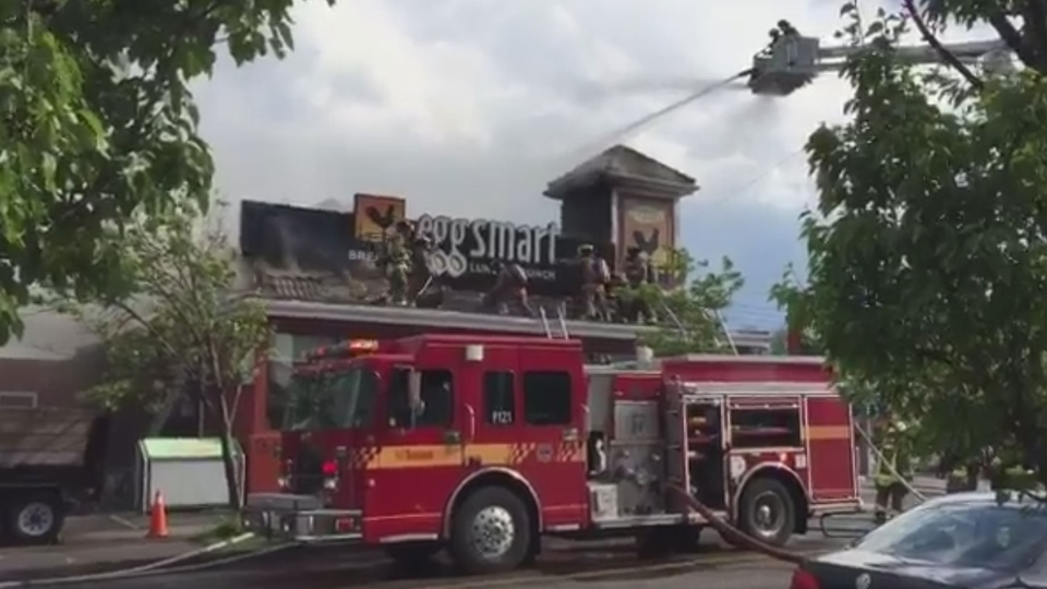 Firefighters douse flames at an Eggsmart restaurant near Yonge Street and Sheppard Avenue in North York Tuesday May 30, 2017. (@tweetabletalk /Twitter)