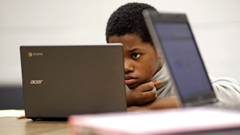 Marquez Allen reads on a laptop computer at Annapolis Middle School in Annapolis, Md., on Feb. 12, 2015. (Patrick Semansky / AP)