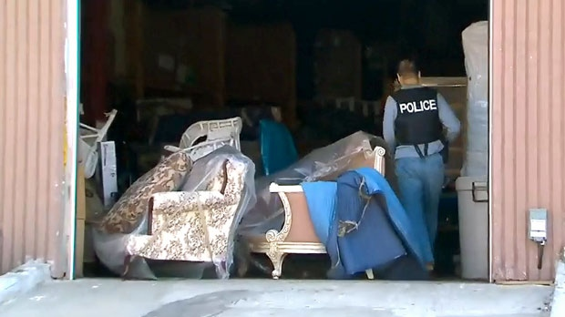 Police officers execute a search warrant at a Scarborough moving company  facility on Mary 17.