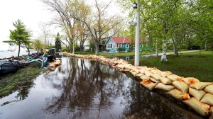 Sandbags keep water from flooding the land more as the Toronto Islands are threatened by rising water levels in Toronto. (Nathan Denette/The Canadian Press)