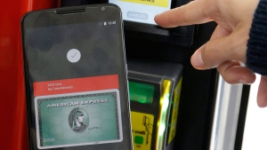 In this May 28, 2015, file photo, a Google employee gives a demonstration of Android Pay on a phone at Google I/O 2015 in San Francisco. (AP Photo/Jeff Chiu, File)