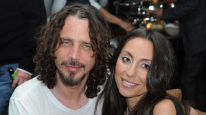"""In this April 27, 2012, file photo, Chris Cornell, at left, and his wife, Vicky Karayiannis attend the celebration of """"Commando: The Autobiography of Johnny Ramone,"""" in Los Angeles. Vicky Cornell.  Cornell says in a statement Thursday, June 1, 2017 that she's still awaiting toxicology reports she hopes will clarify the circumstances around her late husband's apparent suicide.  (AP Photo/Katy Winn, File)"""
