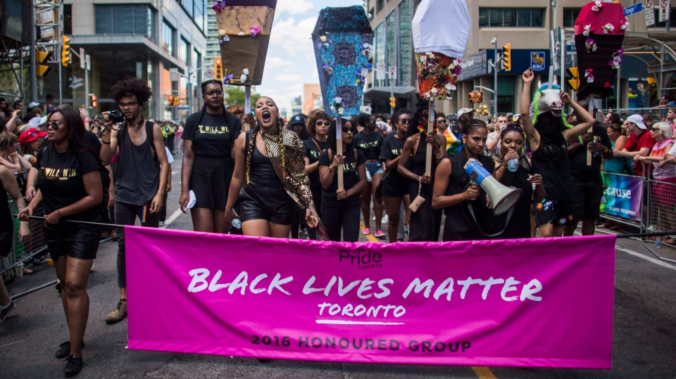 People from the Black Lives Matter lead the annual Pride Parade, in Toronto on Sunday, July 3, 2016. (Mark Blinch/The Canadian Press)