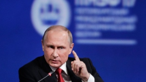 In this Friday, June 2, 2017, file photo, Russian President Vladimir Putin gestures as he speaks at the St. Petersburg International Economic Forum in St. Petersburg, Russia. (AP Photo/Dmitry Lovetsky, File)