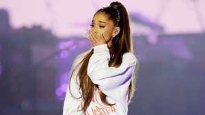 In this Sunday, June 4, 2017, handout photo provided by Dave Hogan for One Love Manchester, singer Ariana Grande is overcome by emotion at the One Love Manchester tribute concert in Manchester, north western England, Sunday, June 4, 2017. One Love Manchester is raising money for those affected by the bombing at the end of Ariana Grande's concert in Manchester on May 22, 2017. (Dave Hogan via AP)
