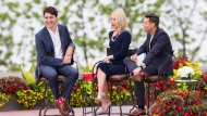 Prime Minister Justin Trudeau, left, speaks with Kelly Ripa, centre, and Ryan Seacrest during his appearance on Live with Kelly and Ryan in Niagara Falls, Ontario on Monday, June 5, 2017. THE CANADIAN PRESS/Aaron Lynett
