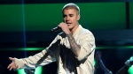 "FILE - In this May 22, 2016 file photo, Justin Bieber performs at the Billboard Music Awards in Las Vegas. Bieber will join Ariana Grande at a charity concert called ""One Love Manchester"" in Manchester, England, Sunday, June 3, 2017, two weeks after a bomber killed 22 people at Grande's concert in Manchester. (Photo by Chris Pizzello/Invision/AP, File)"