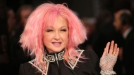 In this April 3, 2016 file photo, actress and singer Cyndi Lauper poses for photographers upon arrival at the Olivier Awards in London. (Photo by Joel Ryan/Invision/AP, File)