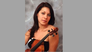 This undated publicity photo provided by her attorney, Philip A. MacNaughton, shows professional violinist Yennifer Correia in Venezuela. (Yennifer Correia/Philip A. MacNaughton via AP)