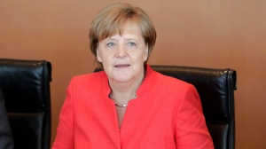 German Chancellor Angela Merkel waits for the beginning of the weekly cabinet meeting at the Chancellery in Berlin, Germany, Wednesday, June 7, 2017. (AP Photo/Michael Sohn)
