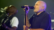 This is a Monday, Aug. 29, 2016, file photo of Phil Collins performs during the opening ceremony for the U.S. Open tennis tournament. (AP Photo/Darron Cummings/File)