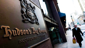 A man walks past the Hudson's Bay Company sign in downtown Toronto on Wednesday, Feb. 4, 2009. (Nathan Denette/The Canadian Press)