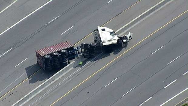 Truck carrying toxic chemical rolls over on QEW, nearby homes evacuated