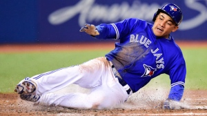 Toronto Blue Jays outfielder Ezequiel Carrera (3) scores on a Justin Smoak single against the Seattle Mariners during fifth inning American League baseball action in Toronto, Thursday, May 11, 2017. THE CANADIAN PRESS/Frank Gunn