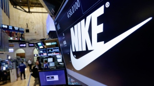 In this Wednesday, March 22, 2017, file photo, the Nike logo appears above the post where it trades on the floor of the New York Stock Exchange. On Thursday, June 15, 2017, Nike said it plans to cut about 1,400 jobs, reduce the number of sneaker styles it offers by a quarter and sell more shoes directly to customers online. The company says the changes to its business structure will help it offer more products to customers faster. (AP Photo/Richard Drew, File)
