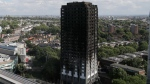 The scorched facade of the Grenfell Tower in London, Thursday, June 15, 2017, after a massive fire raced through the 24-storey high-rise apartment building in west London early Wednesday. Firefighters are beginning the task of combing through the devastated apartment tower, Thursday, checking integrity of the structure and searching to find victims.(AP Photo/Frank Augstein)