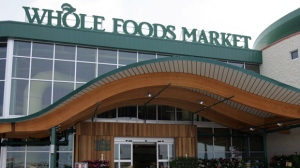 In this May 9, 2007 file photo, customers are seen outside a Whole Foods Market in Dallas.   Online juggernaut Amazon announced Friday, June 16, 2017, that it is buying Whole Foods in a deal valued at about $13.7 billion, including debt. Amazon.com Inc. will pay $42 per share of Whole Foods Market Inc. AP Photo/LM Otero, file)