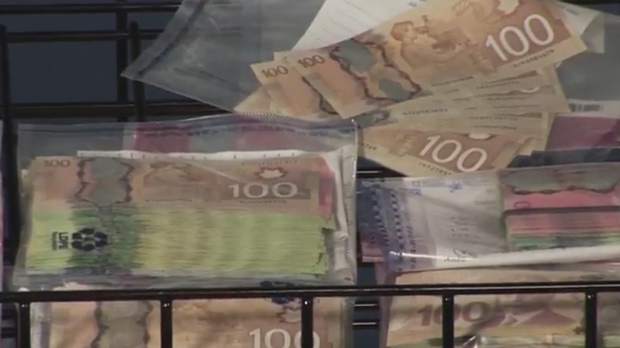 """Some of the $177,000 seized as part of """"Project Kronic"""" is shown at TPS HQ on June 16, 2017. (TPS)"""