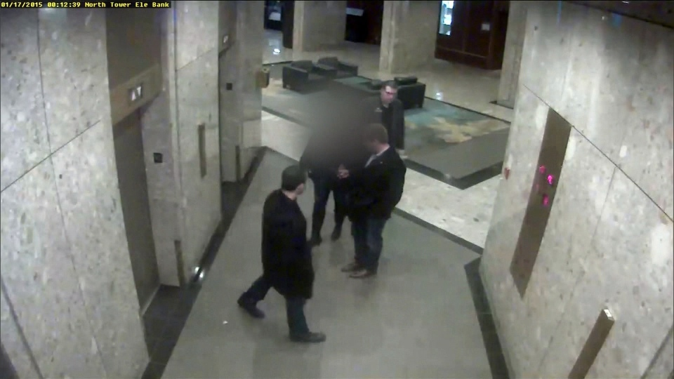 Officers now acquitted of sexual assault are seen in surveillance camera footage from a hotel lobby on Jan. 17, 2015.