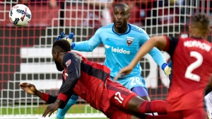 D.C. United goalkeeper Bill Hamid (28) keeps his eyes on the ball as Toronto FC forward Jozy Altidore (17) makes a diving header during first half MLS soccer action in Toronto, Saturday, June 17, 2017. THE CANADIAN PRESS/Frank Gunn
