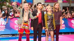 Cole Whittle, left to right, Joe Jonas, Jinjoo Lee and Jack Lawless of DNCE arrive on the red carpet at the 2017 Much Music Video Awards in Toronto on Sunday, June 18, 2017. THE CANADIAN PRESS/Nathan Denette